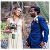 bride and groom with bright floral bouquet at woodland ceremony