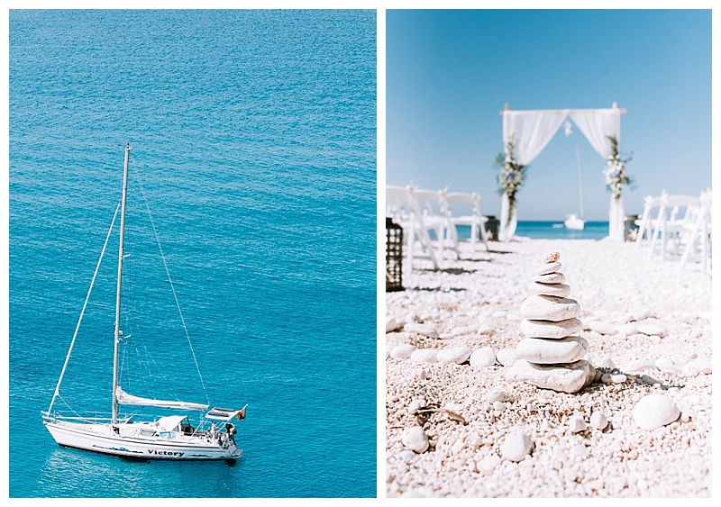 beach pebble tower on white sand beach in front of wedding arch at porto katski beach lefkada