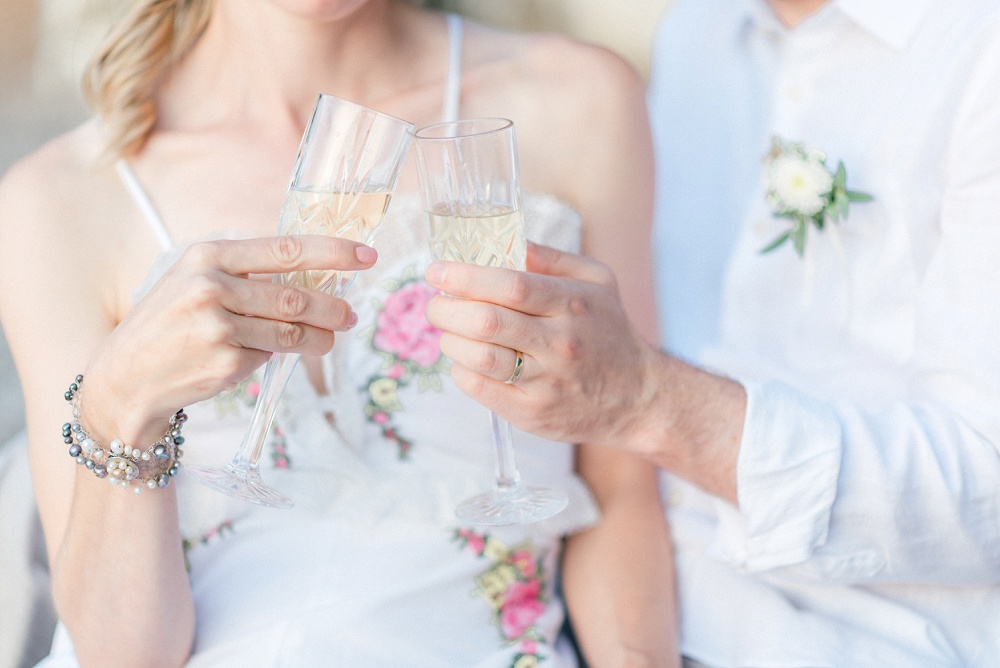 Couple's champagne celebration after their elopement planned by Lefkas Weddings