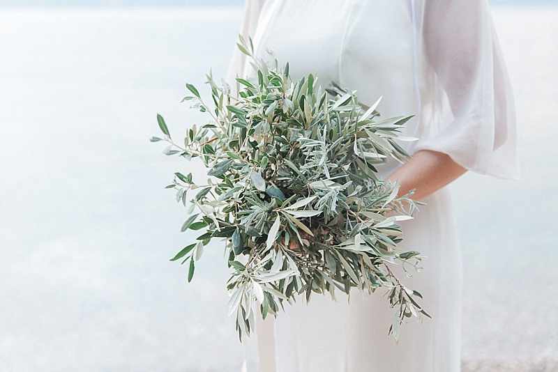Bride holding olive bouquet