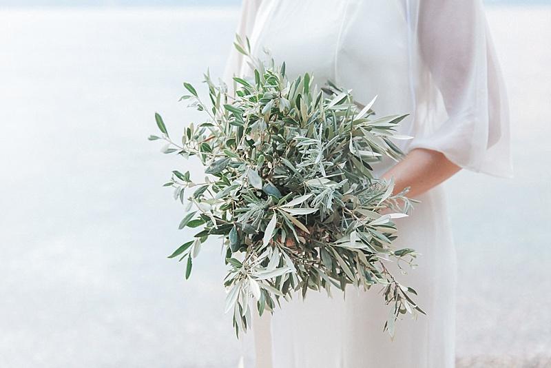 Bride holding olive bouquet