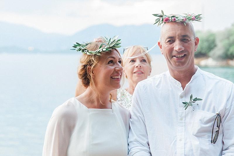 Couple wearing Greek stefana during their vow renewal on Meganisi island