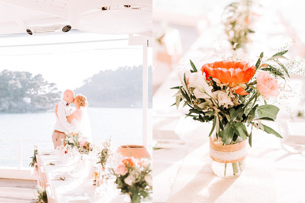 Couple kissing surrounded by coral table decor at Parga Wedding by Lefkas Weddings