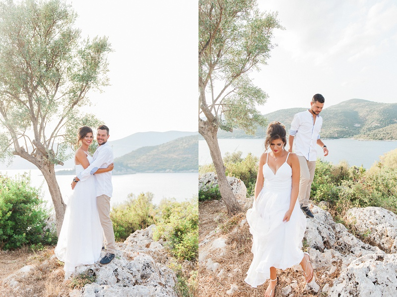 Happy Couple standing on the Rocks at their Lefkada Elopement