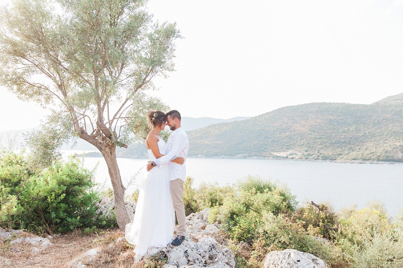 Couple Hugging on the Rocks at Their Secret Beach Elopement on Lefkada
