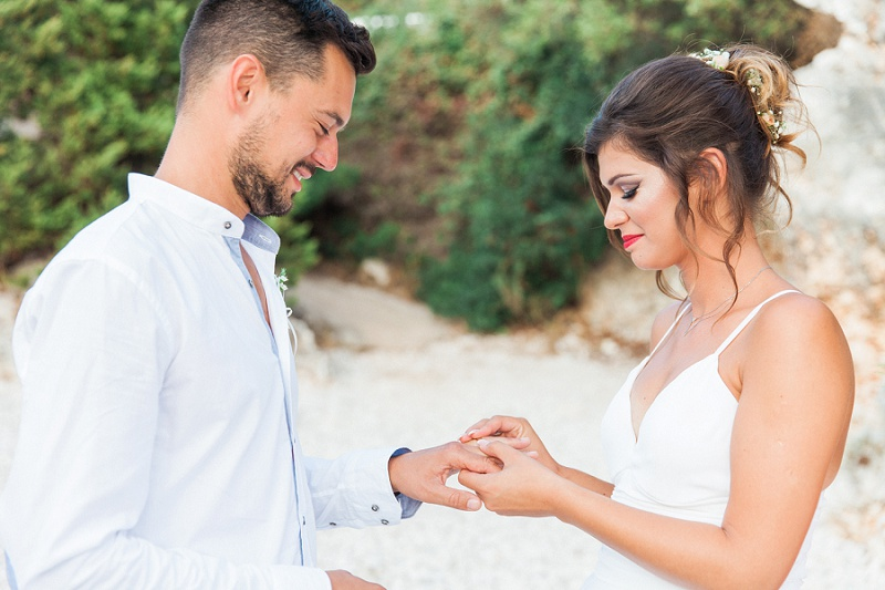 Bride and Groom Exchanging Rings at their Secret Beach Elopement on Lefkada