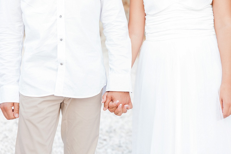 Bride and Groom Holding Hands During their Secret Beach Elopement on Lefkada