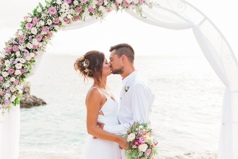 Bride and Grooms First Kiss at their Secret Beach Elopement on Lefkada