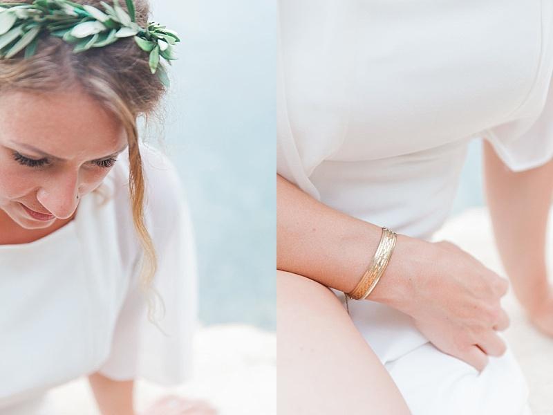 Bride close up wearing olive head garland and gold bracelet