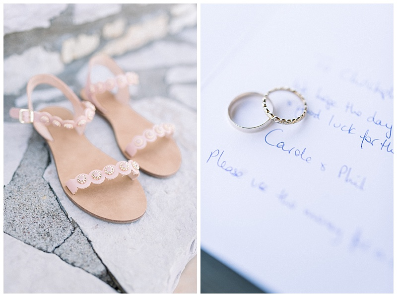 Bride shoes at Greek villa and close up of rings on wedding card with writing