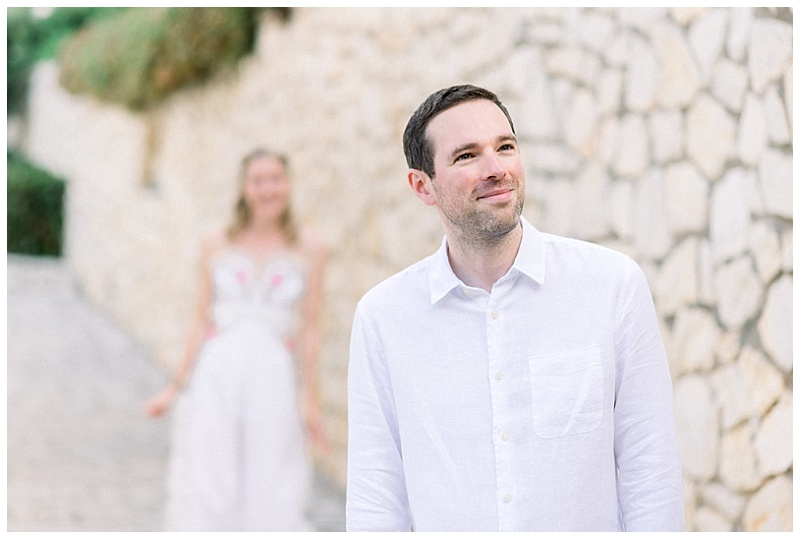 Groom waiting expectantly smiling to see Bride for first look at elopment in Meganisi