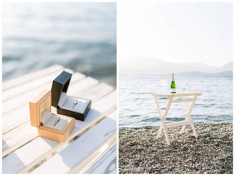 Close up of ring boxes and white table with champagne on beach in Meganisi Greece