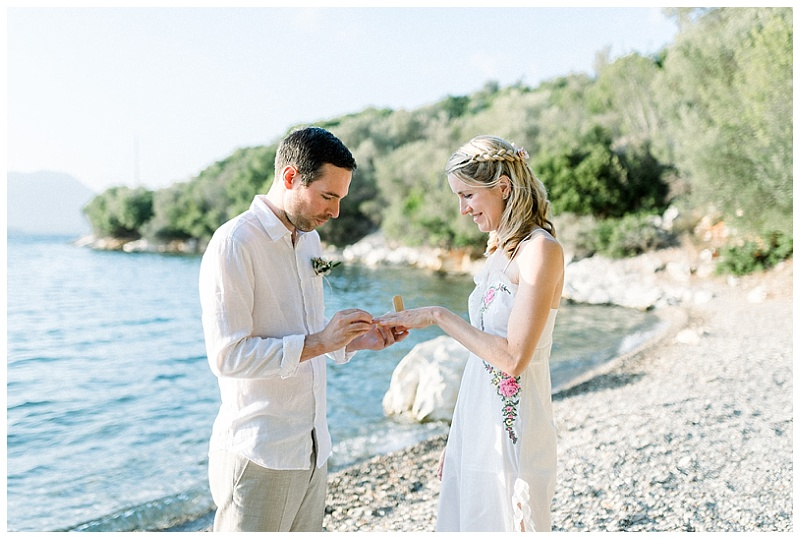 Bride and Groom exchanging rings at beach elopment in Meganisi Greece