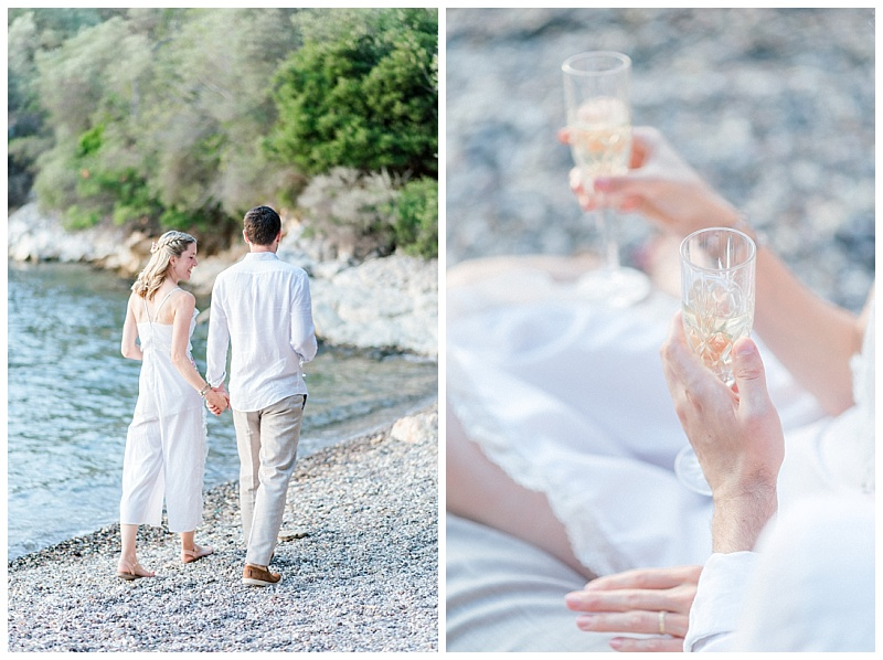 Bride and Groom hand in hand on beach in Meganisi with champagne glasses