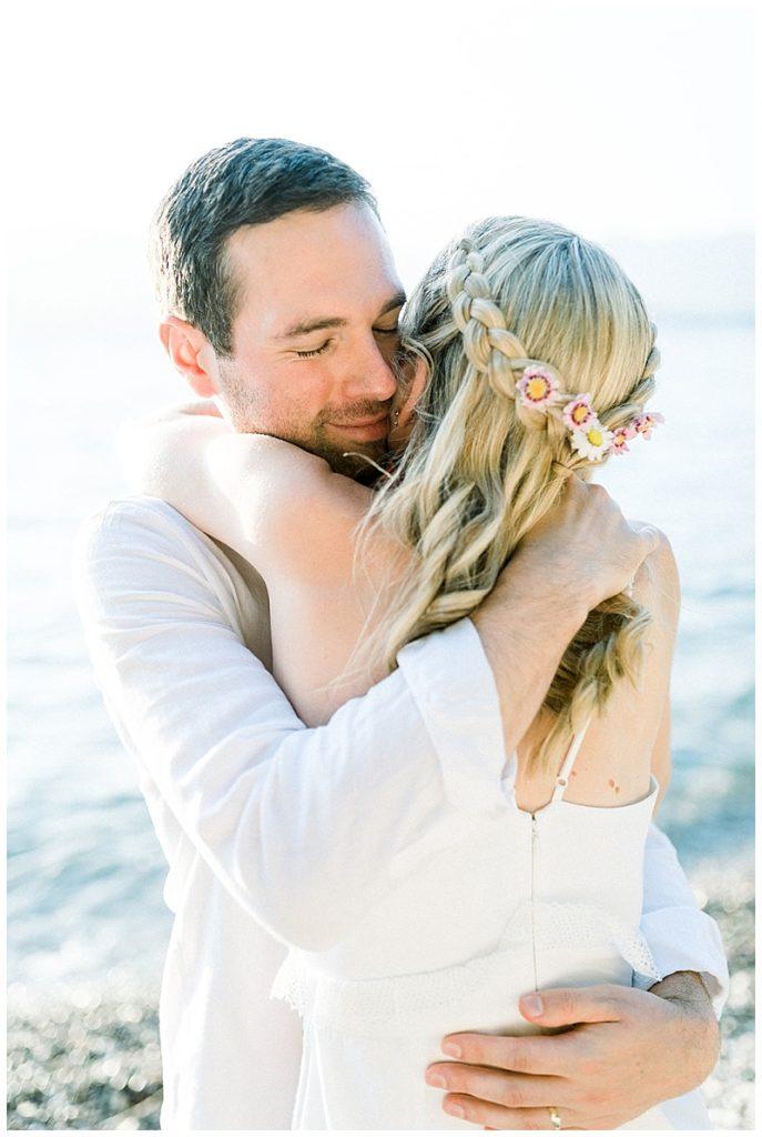 Bride and Groom close up hugging at beach elopement in Meganisi