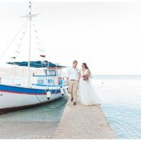 Bride and Groom with blue and white Greek caique traditional boat