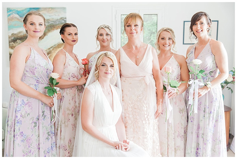 Portrait of Bride surrounded by bridesmaids and her mother