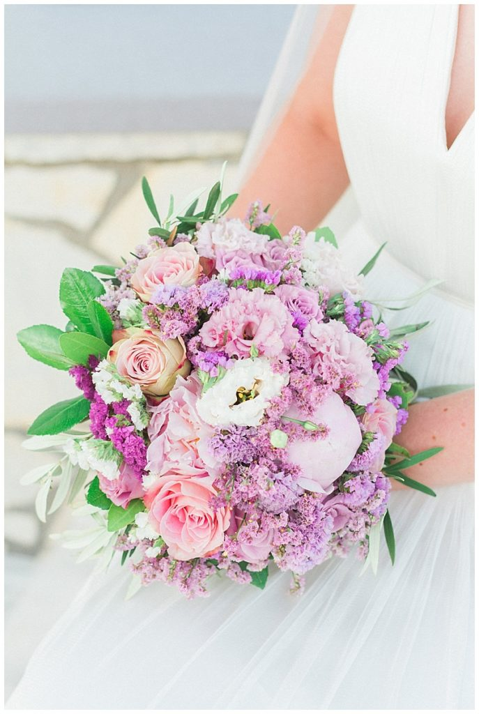 pink bride bouquet with peonies roses lisianthus and limonium