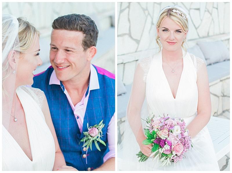 Bride sat at Seaside restaurant lefkada holding pink spring flower bouquet