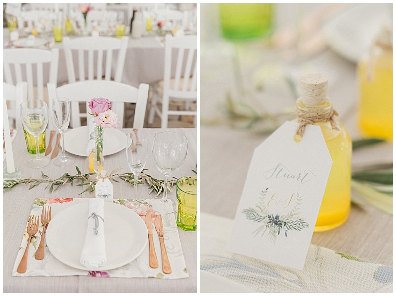 Spring wedding table decor with olive flowers and limoncello bottles