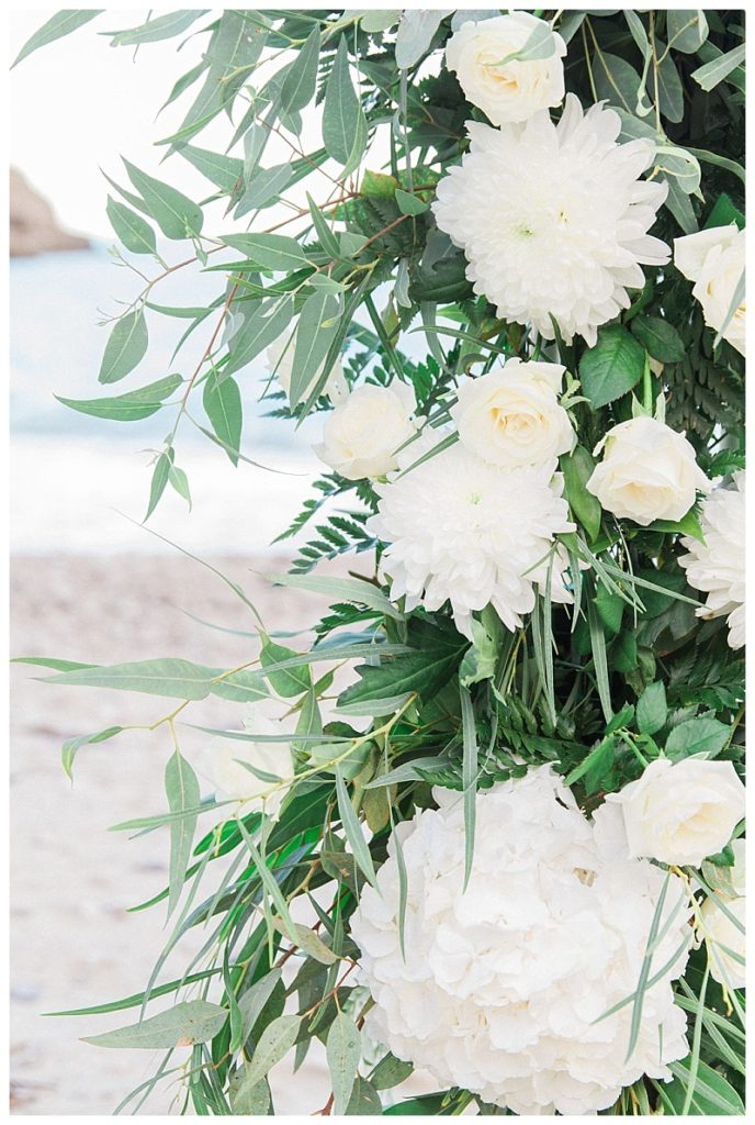 Close up of white hydrangea and eucalyptus wedding arch flowers