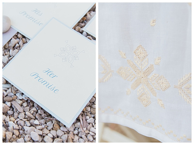 Close up of vow card and Lefkada Karsaniko embroidery on a white tablecloth