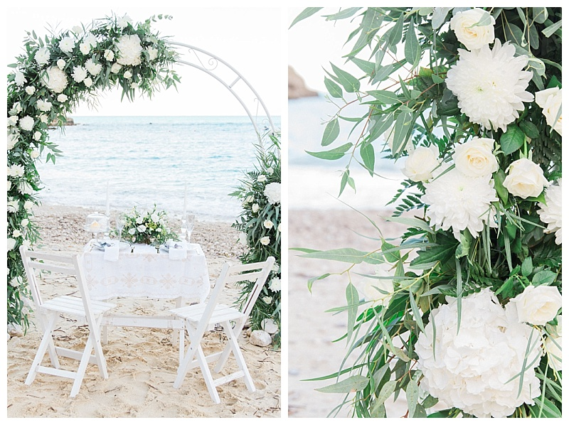 Close up of white hydranges and roses on beach wedding arch in Lefkada