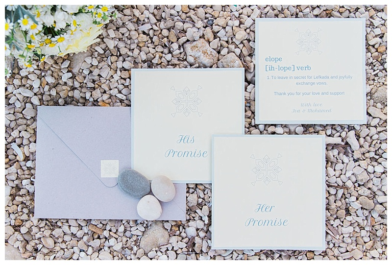 Flatlay of beach elopement stationery on the sand