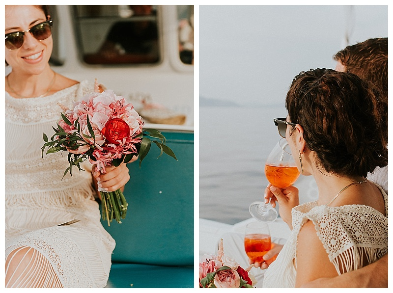 bride sat on wedding boat drinking aperol holding pink bouquet