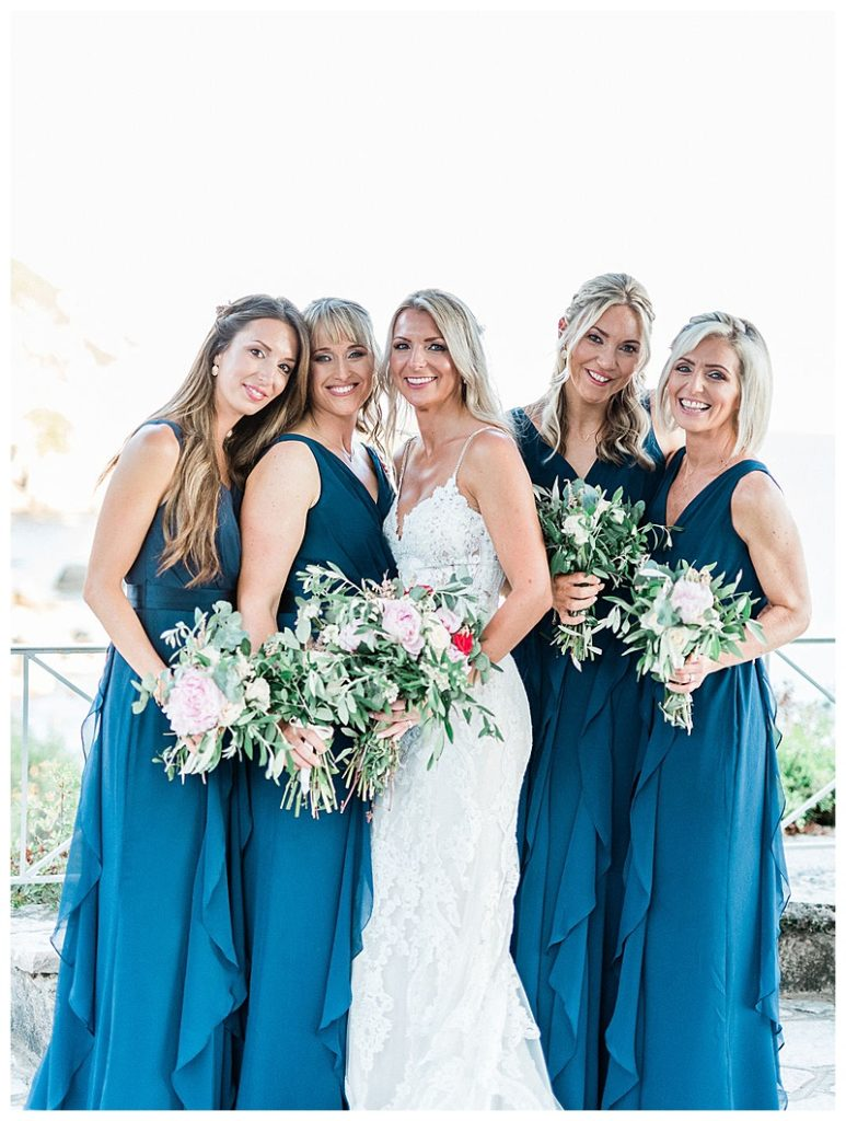 Bride and four bridesmaids in classic blue vera wang maxi dresses holding white and green bouquets
