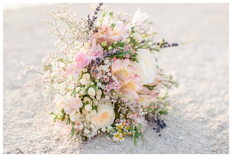 pastel mixed flower bouquet on sands at Pefkoulia beach lefkada