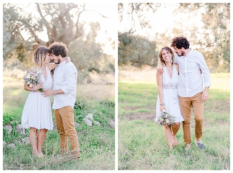 Couple alking arm in arm in olive grove