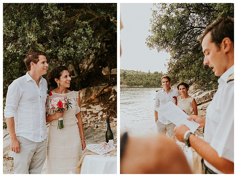 elopement couple standing together on beach at ceremony by captain