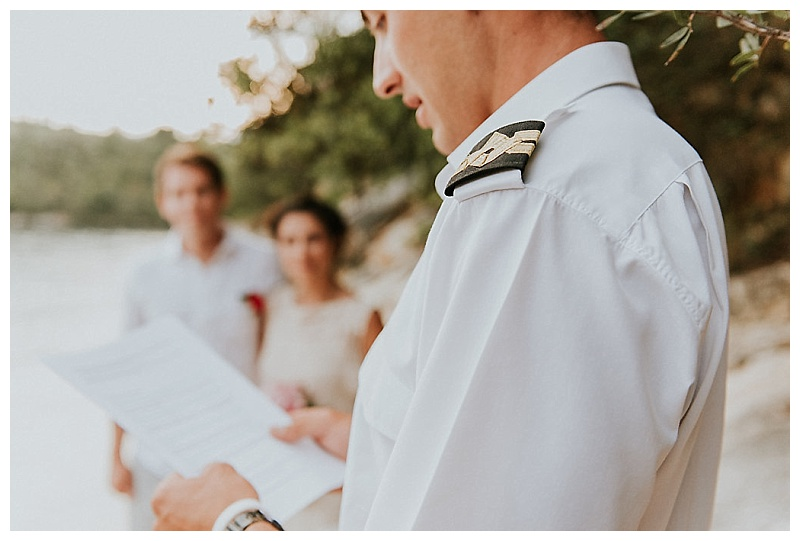 captain reading ceremony wording at elopement ceremony