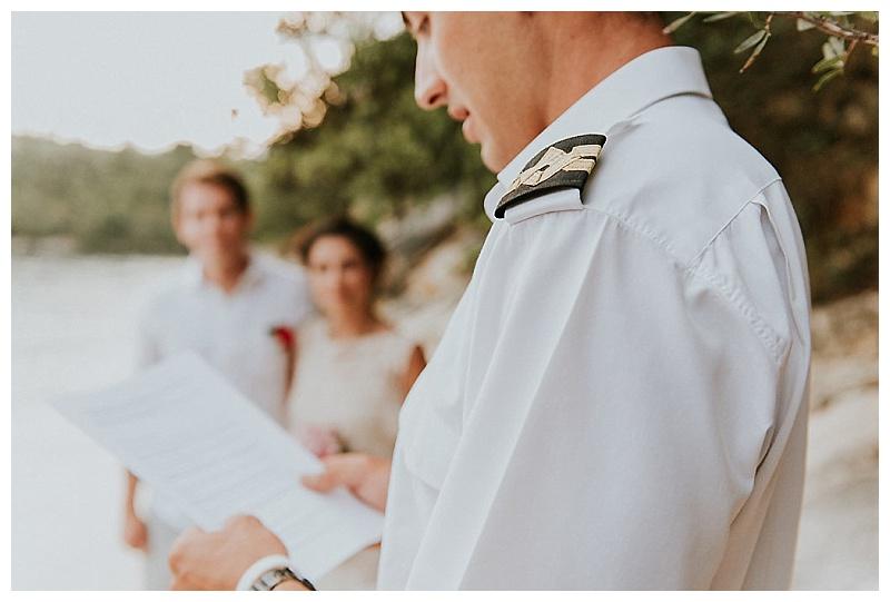 captain reading ceremony wording at elopement ceremony
