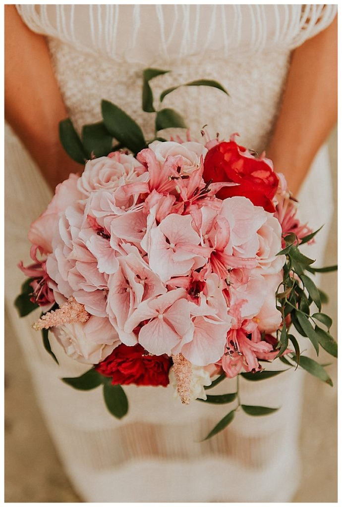 close up of pink and fuschia peony bride bouquet
