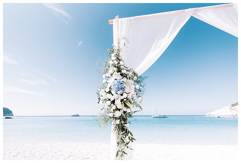 wedding arch flowers at porto katsiki beach lefkada