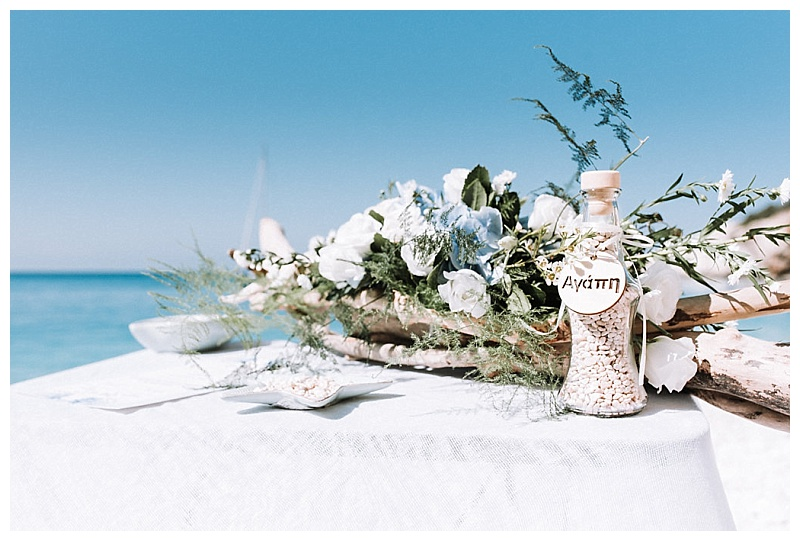 ceremony flowers on table at porto katsiki beach lefkada