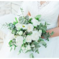 White peony, rose, wax flower and eucalyptus bride bouquet