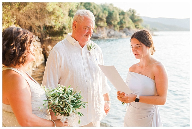 daughter doing reading to parents at beach vow renewal ceremony