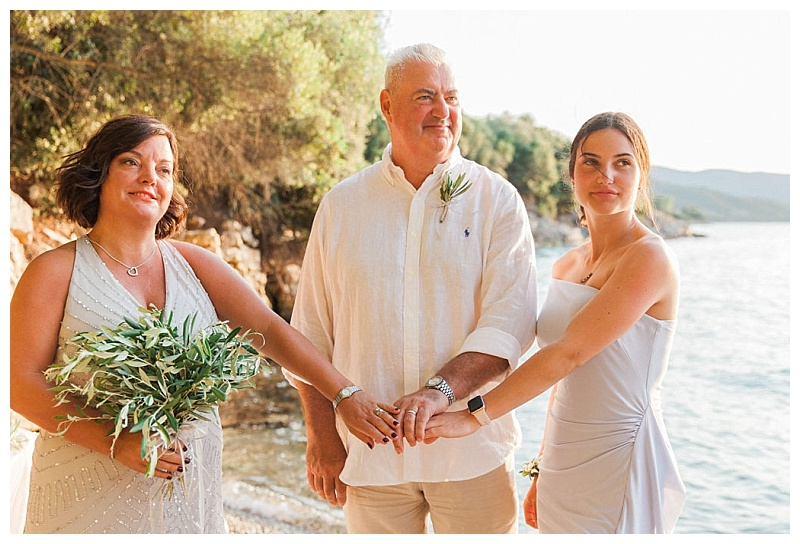 parents and daughter with hands joined at vow renewal ceremony