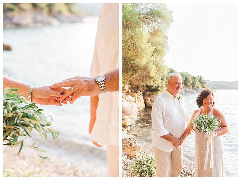 couple holding hands on beach with olive bouquet