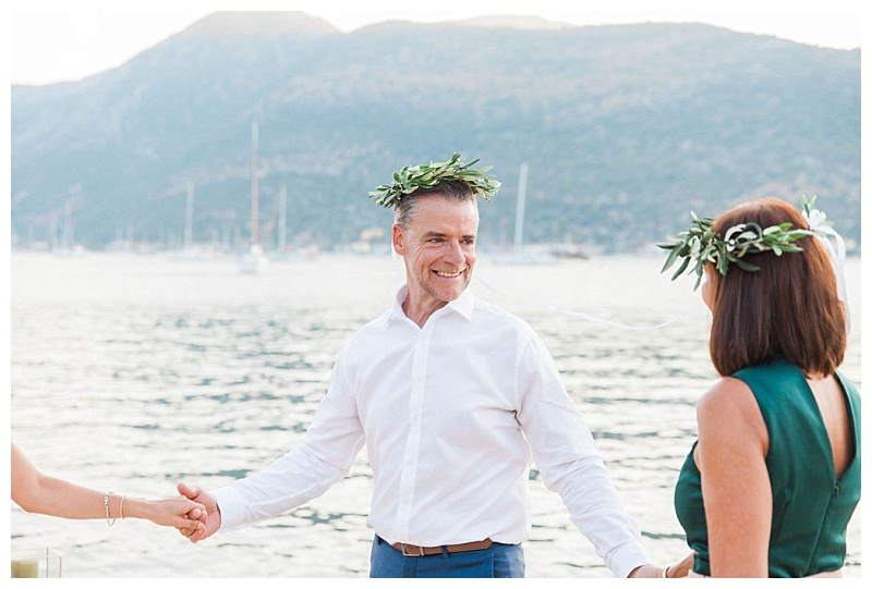 couple with olive crowns at vow renewal ceremony