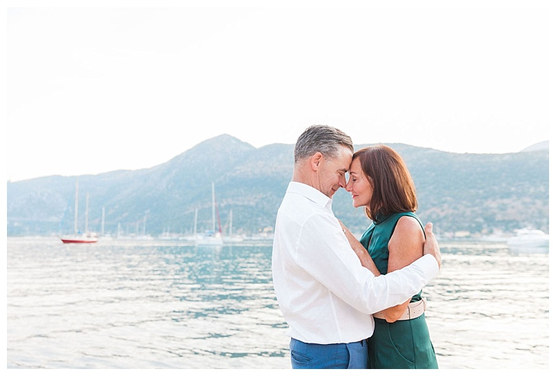 Couple with foreheads touching and eyes closed by the sea at Seaside Lefkada