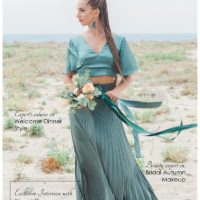 bridal magazine front cover with girl in emerald dress standing on beach