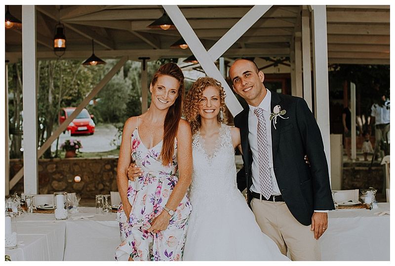 wedding planner with bride and groom