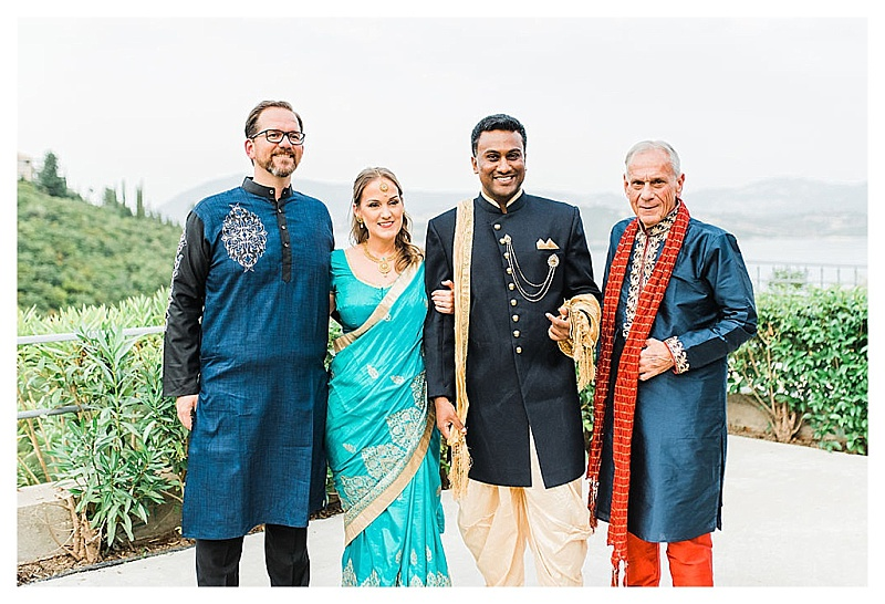 bride groom and guests at mehndi indian inspired arty in greece