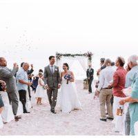 luxury beach wedding confetti throw with bride and groom