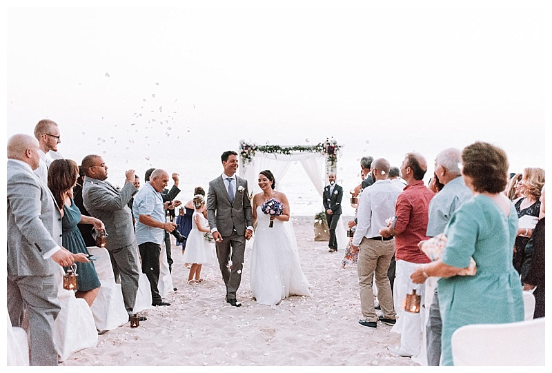 luxury beach wedding confetti throw with bride and groom