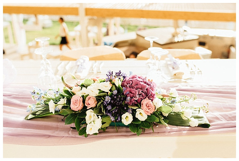 pink and purple floral arrangement for sweetheart table